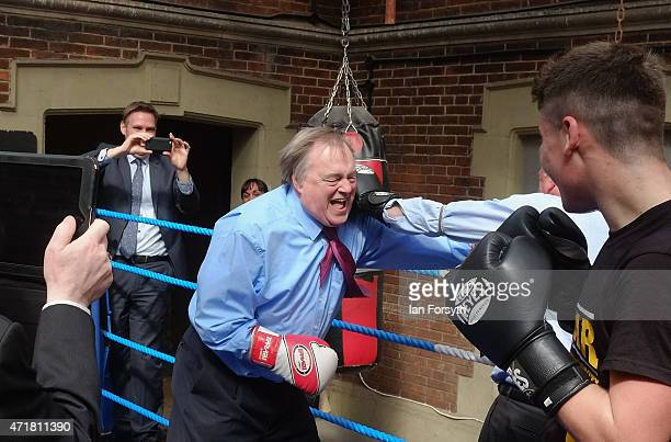 Former Deputy Leader of the Labour Party and Deputy Prime Minister Lord John Prescott climbs into the ring to spar with journalist Michael Crick as...