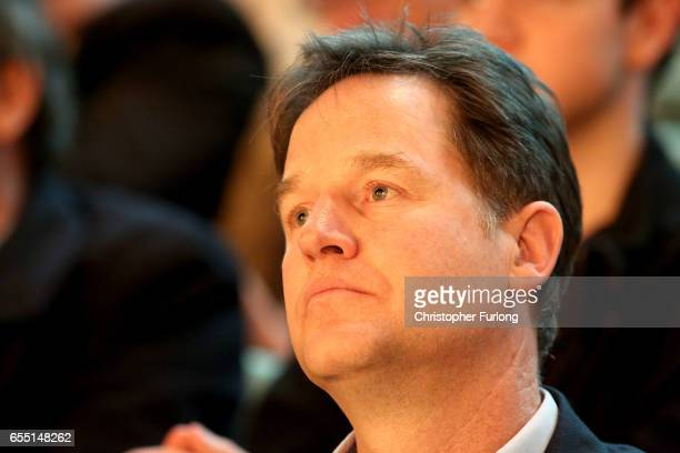 Former deputy prime minister Nick Clegg listens to Liberal Democrats party leader Tim Farron deliver his keynote speech to party members on the last...