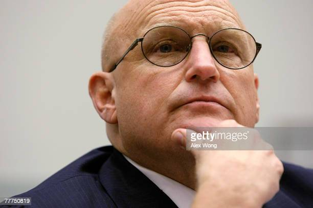 Former Deputy Secretary of State Richard Armitage listens to a question during a hearing before the National Security and Foreign Affairs...
