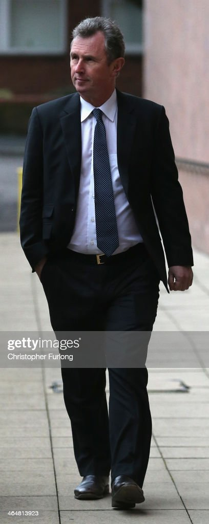 Former Deputy Speaker <a gi-track='captionPersonalityLinkClicked' href=/galleries/search?phrase=Nigel+Evans&family=editorial&specificpeople=2486752 ng-click='$event.stopPropagation()'>Nigel Evans</a> arrives at Preston Crown Court for a a pre-trial hearing to face charges of sexual assault on January 24, 2014 in Preston, Lancashire. Mr Evans resigned from his position as the House of Commons deputy speaker last year. The MP for Ribble Valley has been charged with two counts of indecent assault, five of sexual assault, and one of rape against seven alleged male victims.