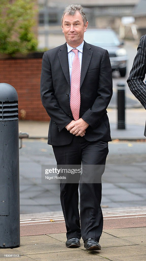 Former Deputy Speaker <a gi-track='captionPersonalityLinkClicked' href=/galleries/search?phrase=Nigel+Evans&family=editorial&specificpeople=2486752 ng-click='$event.stopPropagation()'>Nigel Evans</a> arrives at Preston Crown Court to face charges of sexual assault on October 4, 2013 in Preston, England. 2013 Mr Evans has resigned from his position as the House of Commons deputy speaker. The MP for Ribble Valley has been charged with two counts of indecent assault, five of sexual assault, and one of rape against seven alleged male victims.