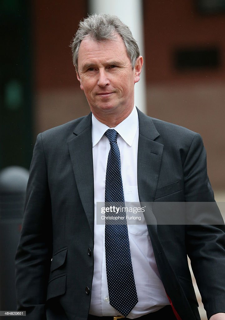 Former Deputy Speaker <a gi-track='captionPersonalityLinkClicked' href=/galleries/search?phrase=Nigel+Evans&family=editorial&specificpeople=2486752 ng-click='$event.stopPropagation()'>Nigel Evans</a> leaves Preston Crown Court after his pre-trial hearing to face charges of sexual assault on January 24, 2014 in Preston, Lancashire. Mr Evans resigned from his position as the House of Commons deputy speaker last year. The MP for Ribble Valley has been charged with two counts of indecent assault, five of sexual assault, and one of rape against seven alleged male victims.