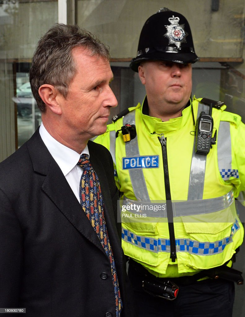 Former deputy speaker of Britain's House of Commons Nigel Evans (L) arrives at Preston Magistrates Court in north-west England, on September 18, 2013, to face two charges of indecent assault, five of sexual assault and one of rape.