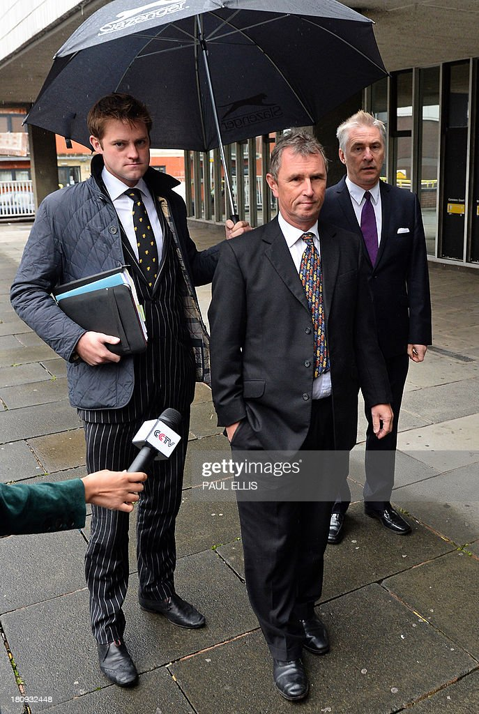 Former deputy speaker of Britain's House of Commons Nigel Evans (C) arrives at Preston Magistrates Court in north-west England, on September 18, 2013, to face two charges of indecent assault, five of sexual assault and one of rape.