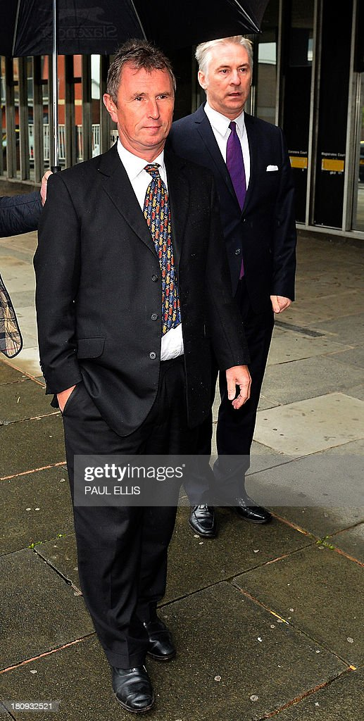 Former deputy speaker of Britain's House of Commons Nigel Evans (L) arrives at Preston Magistrates Court in north-west England, on September 18, 2013, to face two charges of indecent assault, five of sexual assault and one of rape. AFP PHOTO/PAUL ELLIS