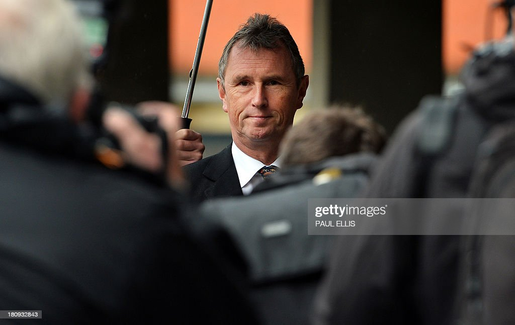 Former deputy speaker of Britain's House of Commons Nigel Evans (C) arrives at Preston Magistrates Court in north-west England, on September 18, 2013, where he faces two charges of alleged indecent assault, five of sexual assault and one of rape.