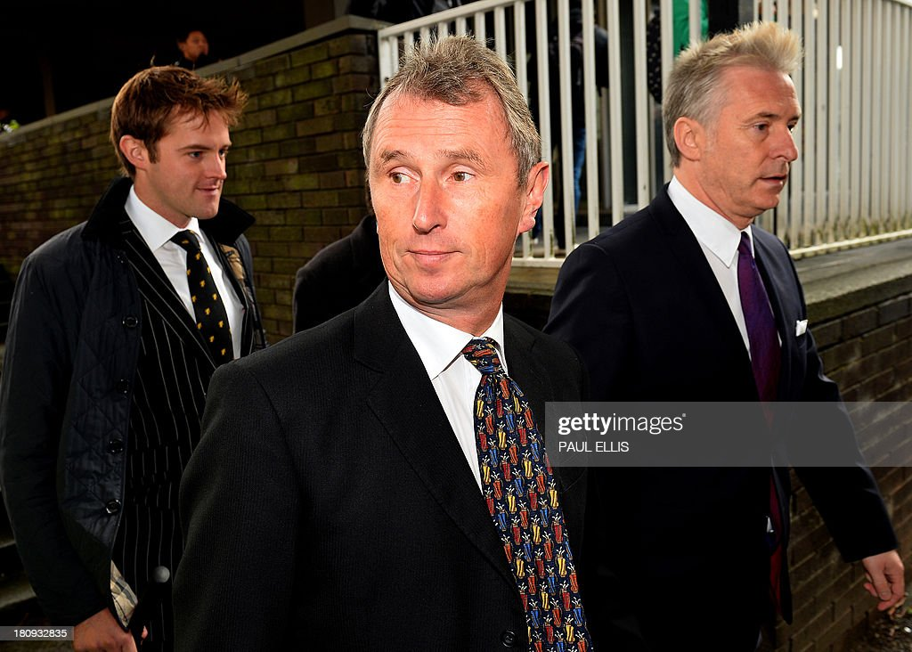 Former deputy speaker of Britain's House of Commons Nigel Evans (C) leaves Preston Magistrates Court in north-west England, on September 18, 2013, where he faced two charges of alleged indecent assault, five of sexual assault and one of rape.