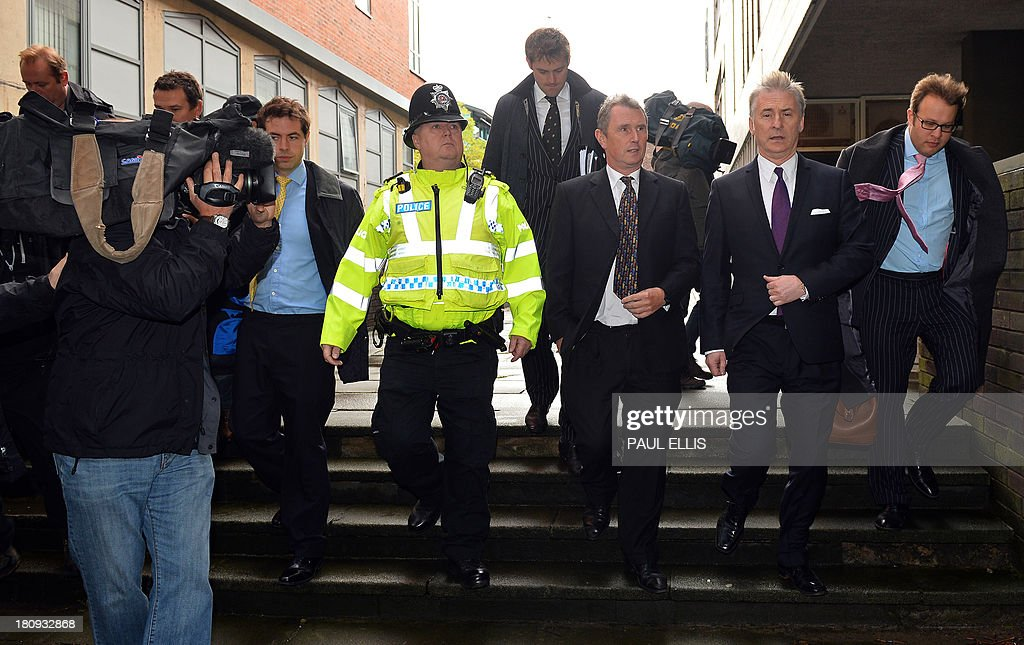 Former deputy speaker of Britain's House of Commons Nigel Evans (4th R) leaves Preston Magistrates Court in north-west England, on September 18, 2013, where he faced two charges of alleged indecent assault, five of sexual assault and one of rape.