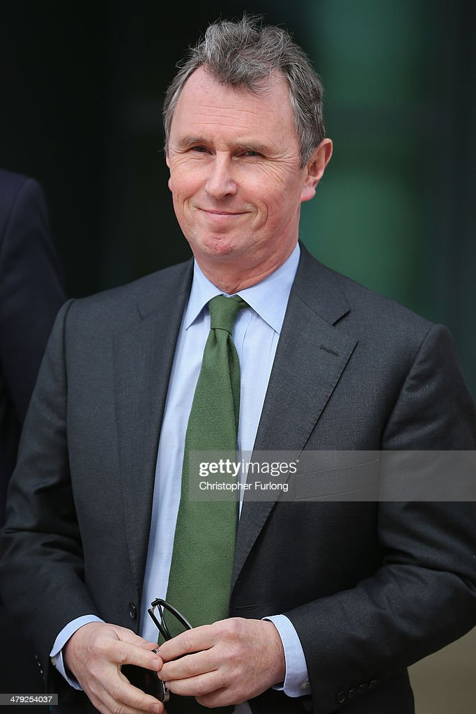 Former deputy speaker of the House of Commons <a gi-track='captionPersonalityLinkClicked' href=/galleries/search?phrase=Nigel+Evans&family=editorial&specificpeople=2486752 ng-click='$event.stopPropagation()'>Nigel Evans</a> leaves Preston Crown Court, during a break, where he stands trial of alleged sexual offences on March 17, 2014 in Preston, Lancashire. <a gi-track='captionPersonalityLinkClicked' href=/galleries/search?phrase=Nigel+Evans&family=editorial&specificpeople=2486752 ng-click='$event.stopPropagation()'>Nigel Evans</a>, the former deputy speaker of the House of Commons is accused of sexual offences against seven men. The 56-year-old faces nine charges dating from 2002 to April 1, 2013. He denies two counts of indecent assault, six of sexual assault and one of rape.