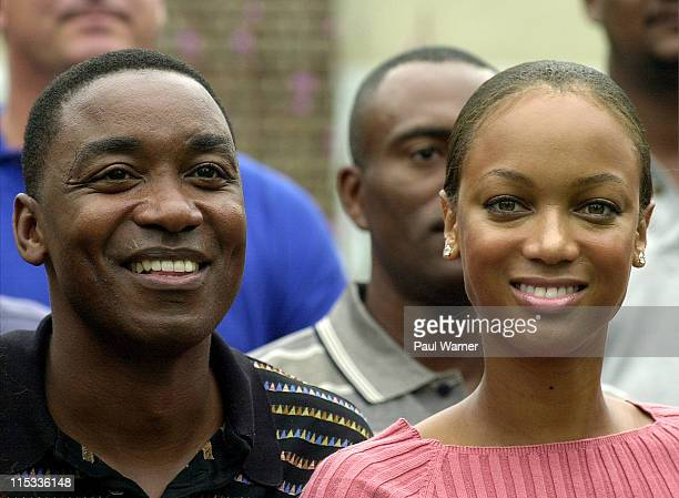 Former Detroit Piston guard and NBA Hall of Fame member Isiah Thomas and Tyra Banks