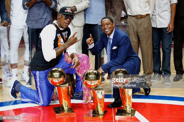 Former Detroit Pistons Isiah Thomas and Dennis Rodman pose with the NBA trophies during a halftime ceremony at the final NBA game at the Palace of...