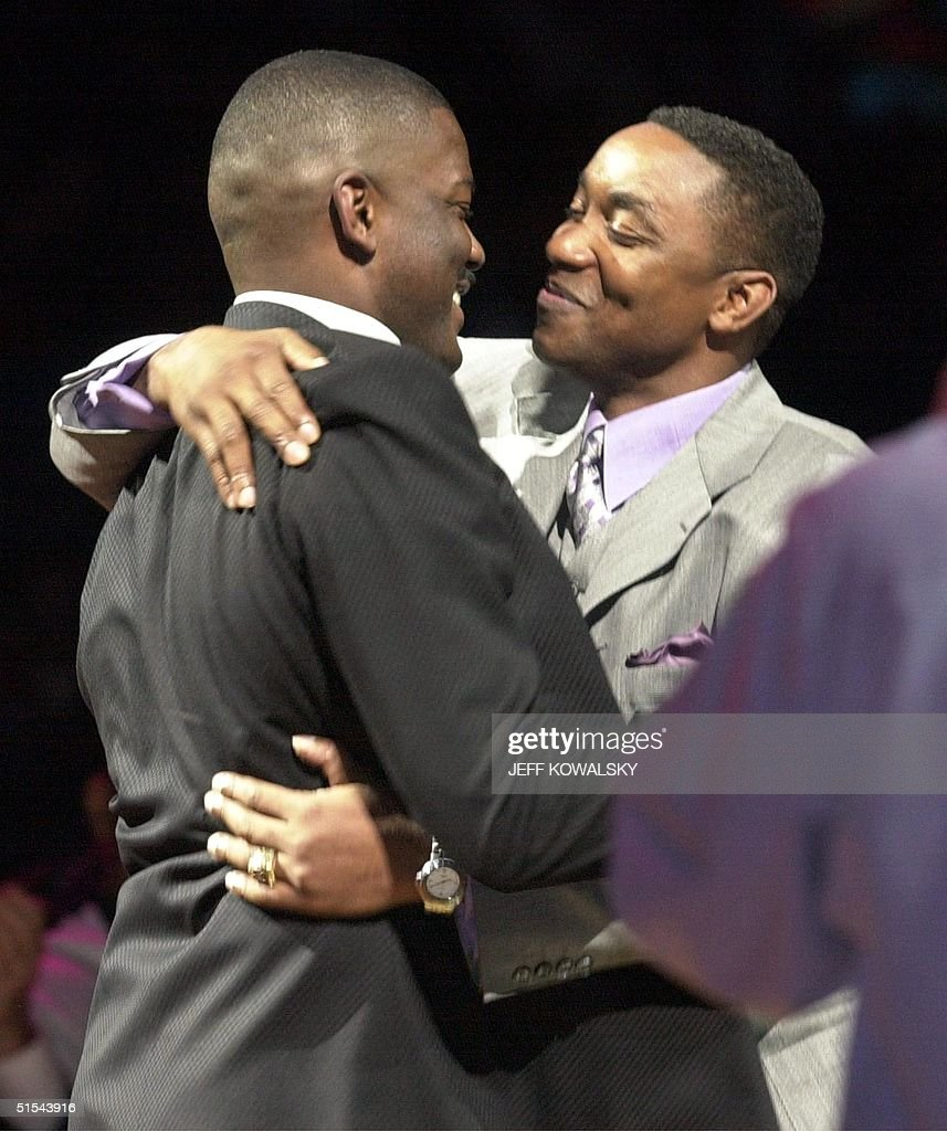 Former Detroit Pistons Joe Dumars L is hugged by