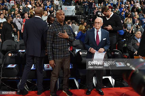 Former Detroit Pistons player Chauncey Billups and former Detroit Pistons coach Larry Brown attend the game honoring former Detroit Pistons player...