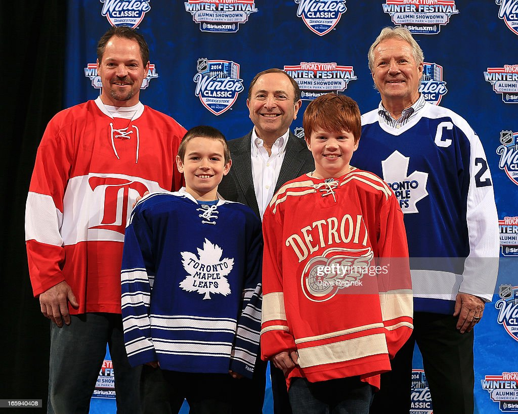Former Detroit Red Wing Joe Kocur and former Toronto Maple Leaf Darryl Sittler take a picture with NHL Commissioner <a gi-track='captionPersonalityLinkClicked' href=/galleries/search?phrase=Gary+Bettman&family=editorial&specificpeople=215089 ng-click='$event.stopPropagation()'>Gary Bettman</a>, Andrew Park and Kienan Draper during the 2014 NHL Winter Classic Press Announcement on April 7, 2013 in Detroit, Michigan.