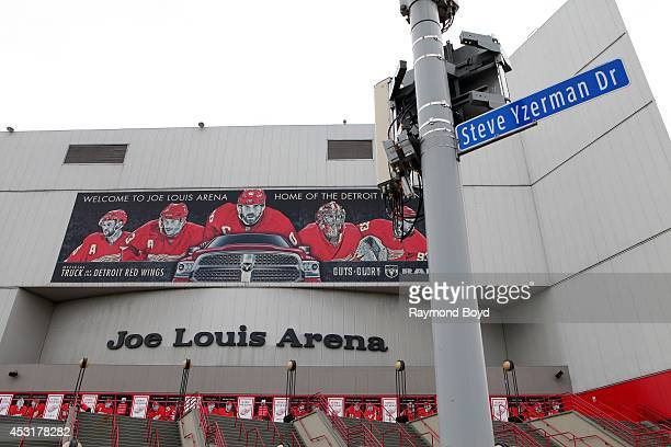 Former Detroit Red Wings hockey player Steve Yzerman's honorary street sign sits outside Joe Louis Arena on July 18 2014 in Detroit Michigan