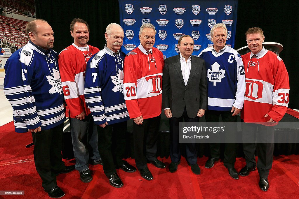 Former Detroit Red Wings Joe Kocur, Mickey Redmond and Kris Draper along with former Toronto Maple Leafs Wendel Clark, Lanny McDonald and Darryl Sittler take a picture with commissioner Gary Bettman during the 2014 NHL Winter Classic Press Announcement on April 7, 2013 in Detroit, Michigan.