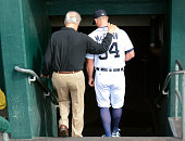 Former Detroit Tigers outfielder and Baseball HallofFamer Al Kaline walks down the dugout steps with current Tigers catcher James McCann#34 prior to...