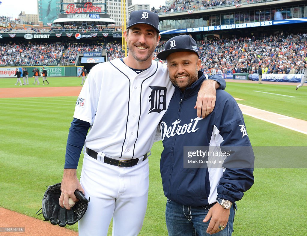 Former Detroit Tigers second baseman Placido Polanco poses for a photo with current Tigers pitcher Justin Verlander after throwing out the ceremonial...