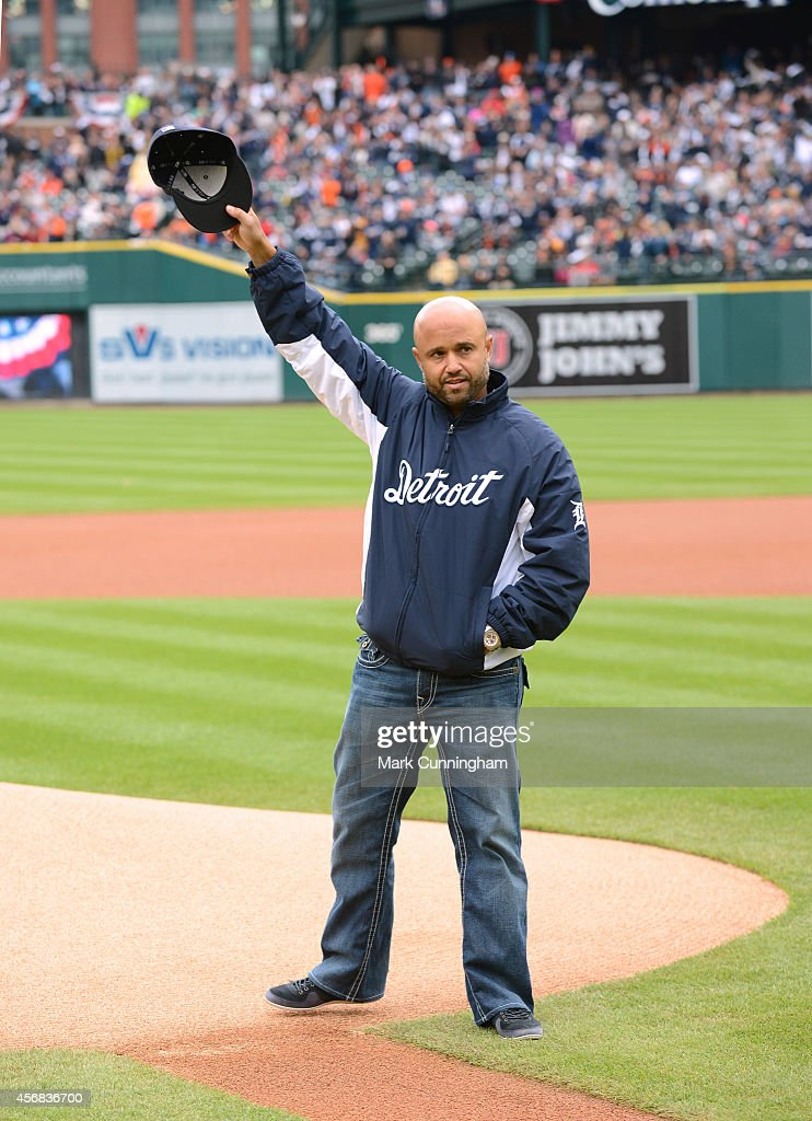 Former Detroit Tigers second baseman Placido Polanco waves to the crowd before throwing out the ceremonial first pitch prior to Game Three of the...