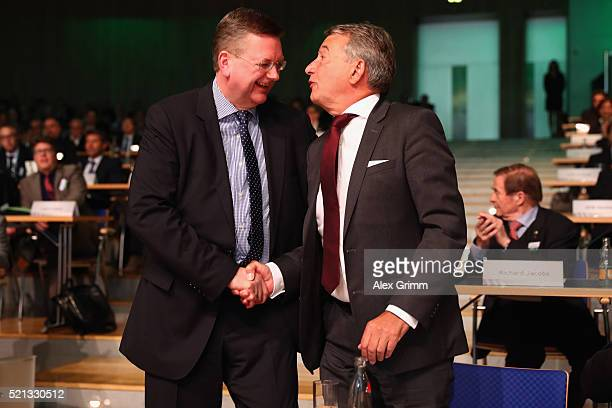 Former DFB President Wolfgang Niersbach congratulates newly elected DFB President Reinhard Grindel during the extraordinary DFB Bundestag at Congress...
