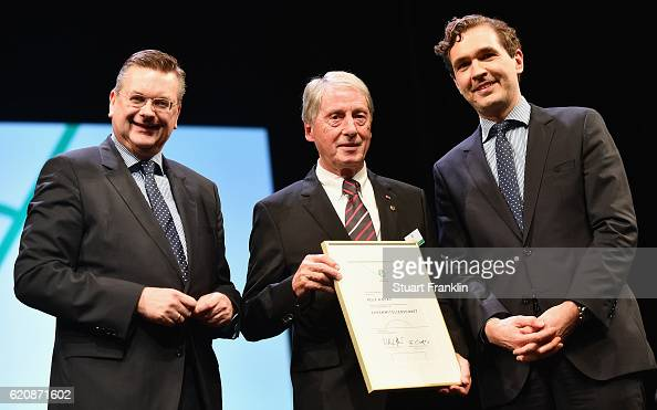 Former DFB vice president Rolf Hocke is honored with the DFB honorary membership by DFB president Reinhard Grindel and DFB General Secretary Dr...