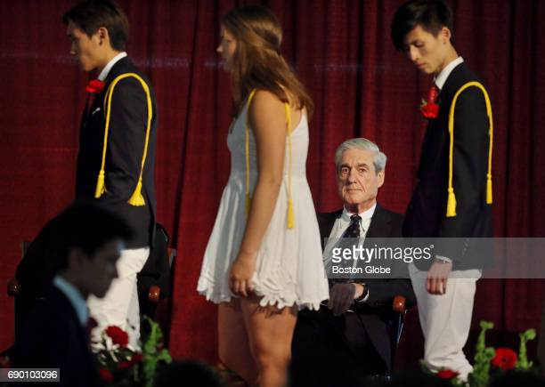 Former Director FBI and Special Counsel Robert S Mueller III watches the Cum Laude Society Induction after addressing graduates at Tabor Academy...