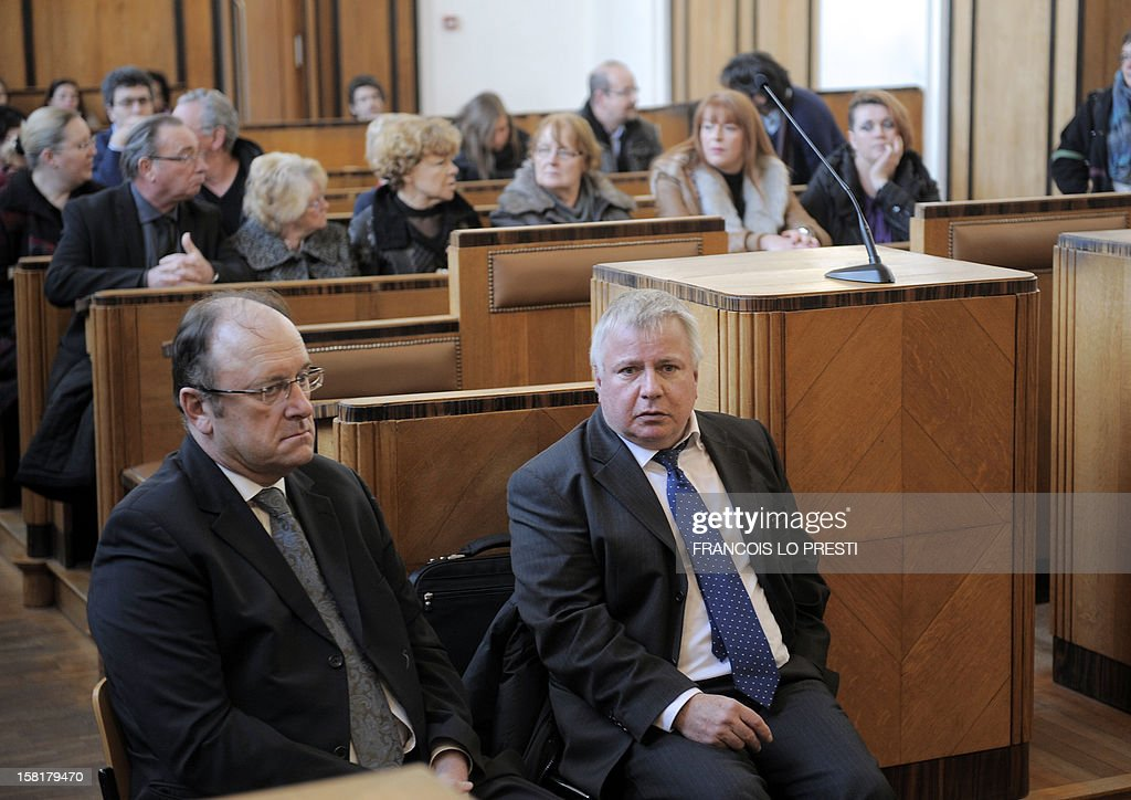 Former Director general of petrochemical plant of Noroxo between November 2003 and January 2004 Johnny Malec (L) and current director Jean-Luc Vinet (R), chat in the Bethune courthouse, northern France on December 10, 2012 during the opening day of the trial against Noroxo for contanimination. Noroxo, part of the Exxon Mobile group, the world's biggest oil producer is tried in a case of an epidemic legionellosis , whose source of contamination was identified as the Noroxo factory in Harnes, and contracted over the 2003 and 2004 period making 83 victims, fourteen of which died. AFP PHOTO / Francois LO