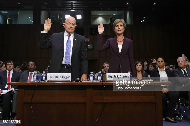 Former Director of National Intelligence James Clapper and former acting US Attorney General Sally Yates are sworn in before testifying to the Senate...