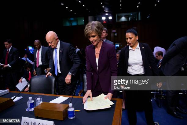 Former Director of National Intelligence James Clapper and former US Deputy Attorney General Sally Yates leave a hearing of the Senate Judicary...