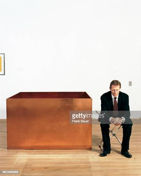 Former director of Tate galleries Nicholas Sirota is photographed next to a work by Ashley Judd on July 18 2007 in London England