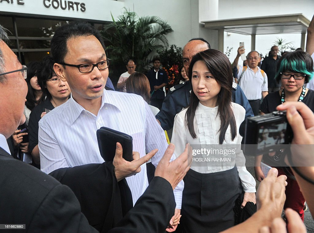 Former director of the Central Narcotics Bureau, Ng Boon Gay (centre L) and his wife leave after a hearing at the Subordinate court in Singapore on February 14, 2013. Ng Boon Gay, a former head of Singapore's narcotics police was cleared of corruption on February 14 after a court rejected charges that he demanded oral sex from a contractor to help her win government deals.