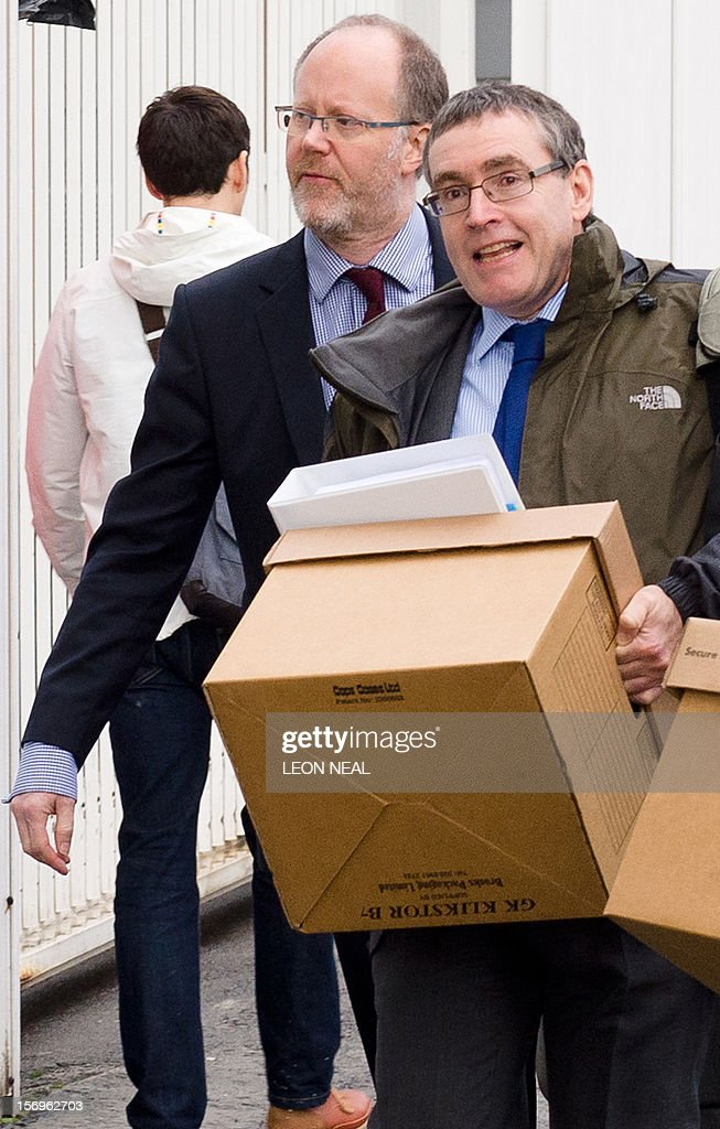 Former director-general of the BBC George Entwistle (L) arrives at the building housing a London solicitors office in central London, on November 26, 2012, the venue of the BBC's Pollard Review. The Pollard Review is the inquiry into the handling of the aborted BBC's Newsnight investigation into alleged television personality sexual abuse by the late Jimmy Savile.