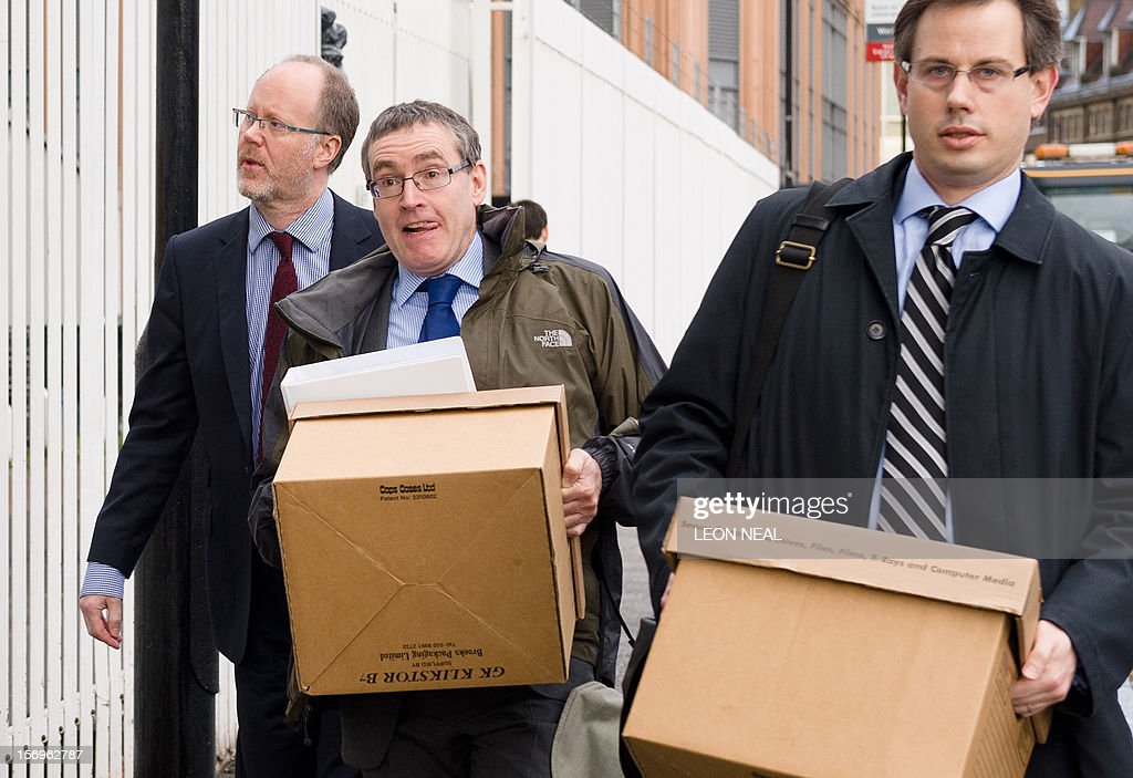 Former director-general of the BBC George Entwistle (L) arrives at the building housing a London solicitors office in central London, on November 26, 2012, the venue of the BBC's Pollard Review. The Pollard Review is the inquiry into the handling of the aborted BBC's Newsnight investigation into alleged television personality sexual abuse by the late Jimmy Savile. AFP PHOTO / LEON NEAL