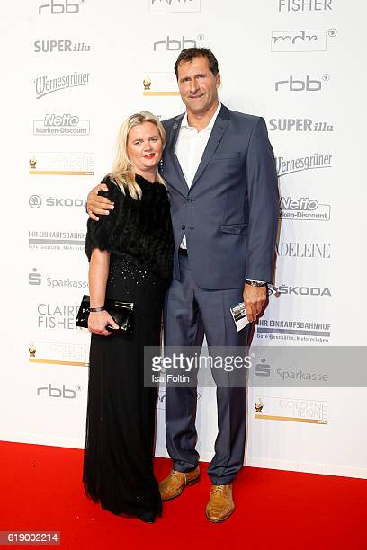 Former discus thrower Lars Riedel and his wife attend the Goldene Henne on October 28 2016 in Leipzig Germany