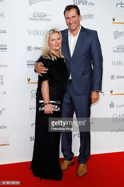 Former discus thrower Lars Riedel and Katja attend the Goldene Henne on October 28 2016 in Leipzig Germany