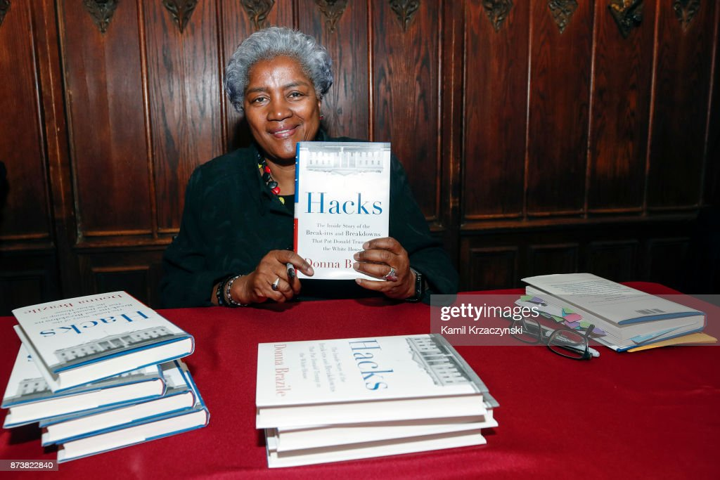 Former DNC Chair Donna Brazile holds her book after speaking at The University of Chicago on November 13, 2017 in Chicago, Illinois. Brazile recently released her book 'Hacks: The Inside Story,' an account of her time as the interim chairperson of the Democratic National Committee during the 2016 presidential campaign.
