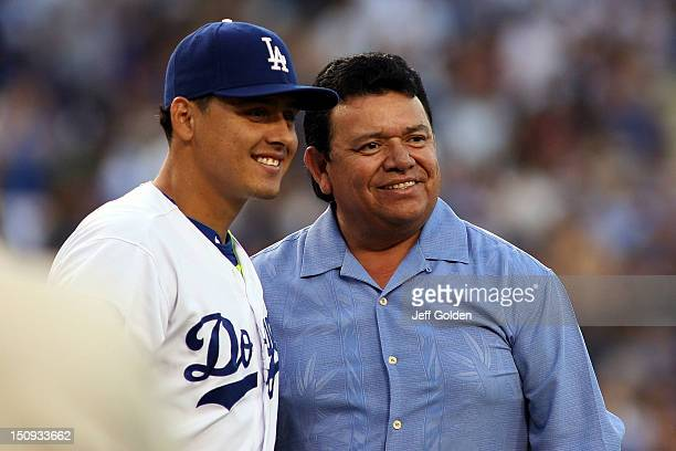 Former Dodger and Spanishradio broadcaster Fernando Valenzuela smiles as he poses for a photo with Luis Cruz of the Los Angeles Dodgers after...