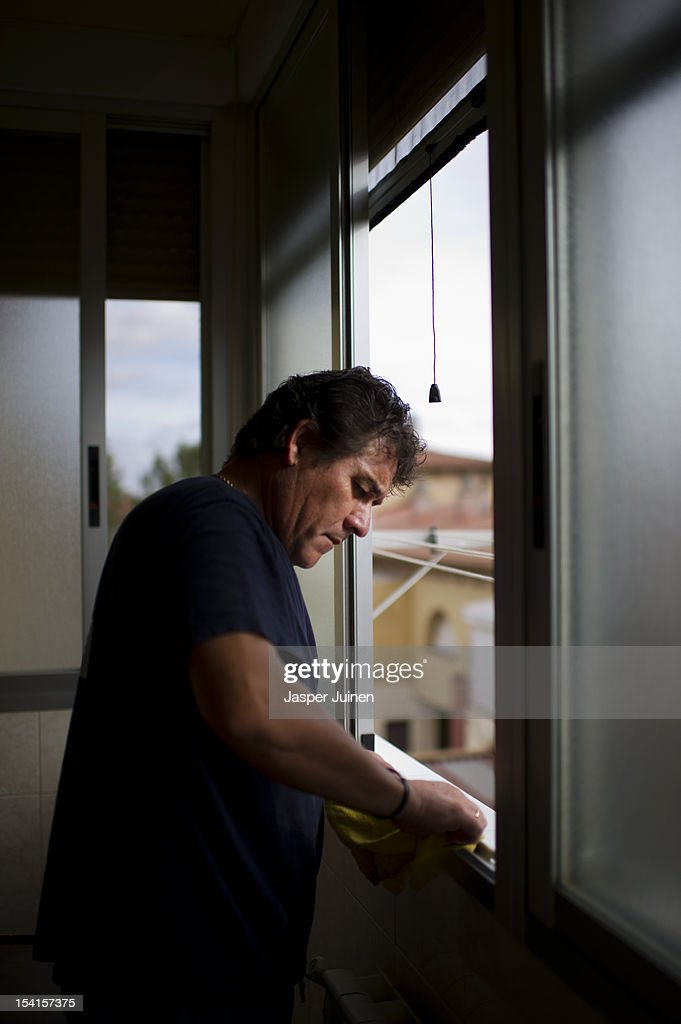 Former door factory worker, forty-eight year old unemployed father of two, Angel Perez Fernandez, helps with the cleaning of his families appartment on October 12, 2012 in the small industrial town of Villacanas, Spain. During the boom years, where in its peak Spain built some 800,000 houses a year, more than Britain, Germany and France combined, and millions of wooden doors where needed, Angel was part of a proud elite enjoying high wages and permanent jobs. Almost all of those doors used came from this small industrial town in the La Mancha province, some seven million a year, leaving with truck loads at the same time, from the now empty and silent Villacanas industrial park. With Spain in recession and the housing bubble busted, the door industry is shattered and unemployment in Villacanas, zero for nearly a generation, is rising fast.