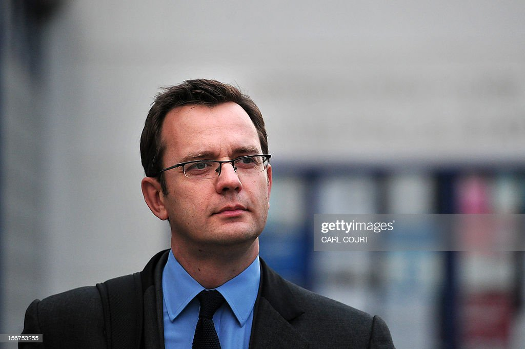 Former Downing Street communications director and News of the World Editor, Andy Coulson, leaves a police station in London on November 20, 2012, where he attended to face charges relating to alleg...