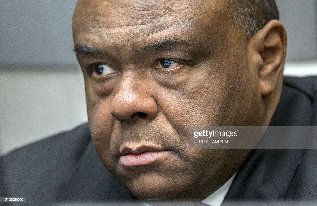 Former DRCongo leader JeanPierre Bemba Gombo waits in a court room of the ICC to hear the delivery of the verdict against him blamed for unbridled...
