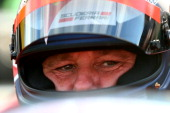 Former driver Gerhard Berger sits in his car before a legends' race after qualifying ahead of the Austrian Formula One Grand Prix at Red Bull Ring on...