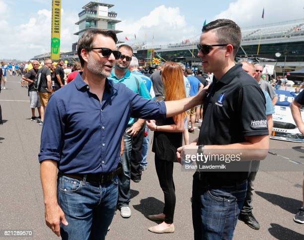 Former driver Jeff Gordon talks to Alex Bowman who will be taking over for Dale Earnhardt Jr driver of the Nationwide Chevrolet on the grid prior to...