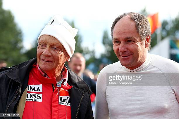 Former drivers Niki Lauda and Gerhard Berger pose together after qualifying for the Formula One Grand Prix of Austria at Red Bull Ring on June 20...