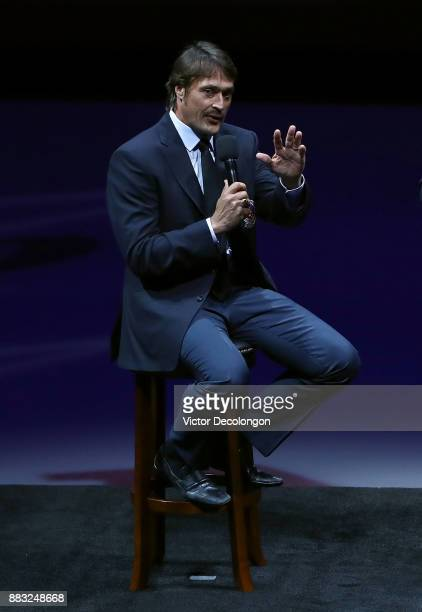 Former Ducks player Teemu Selanne speaks at center ice about his and former teammate Paul Kariya's induction into the Hockey Hall of Fame during the...