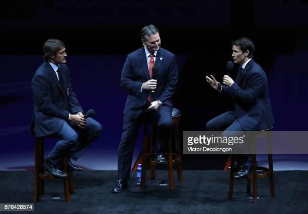 Former Ducks players Teemu Selanne and Paul Kariya and Ducks commentator Brian Hayward speak at center ice about Selanne's and Karyiya's induction...