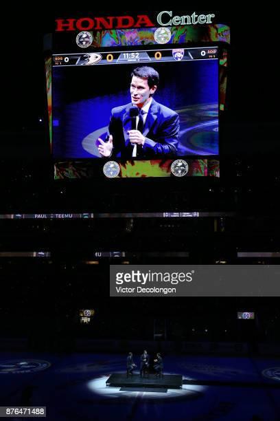 Former Ducks players Teemu Selanne and Paul Kariya and Ducks commentator Brian Hayward speak at center ice about Selanne's and Kariya's induction...