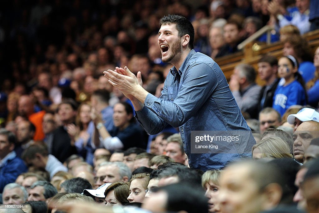 Former Duke Blue Devils player <a gi-track='captionPersonalityLinkClicked' href=/galleries/search?phrase=Brian+Zoubek&family=editorial&specificpeople=4091585 ng-click='$event.stopPropagation()'>Brian Zoubek</a> cheers during a game against the Miami Hurricanes at Cameron Indoor Stadium on March 2, 2013 in Durham, North Carolina. Duke defeated Miami 79-76.