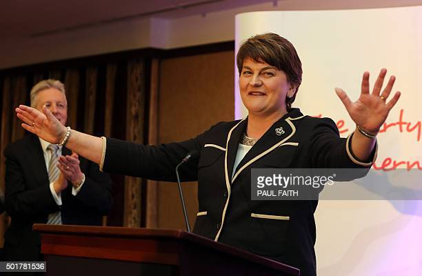 Former DUP leader Peter Robinson claps as the new leader Arlene Foster Northern Ireland Finance Minister in Belfast speaks after the election contest...
