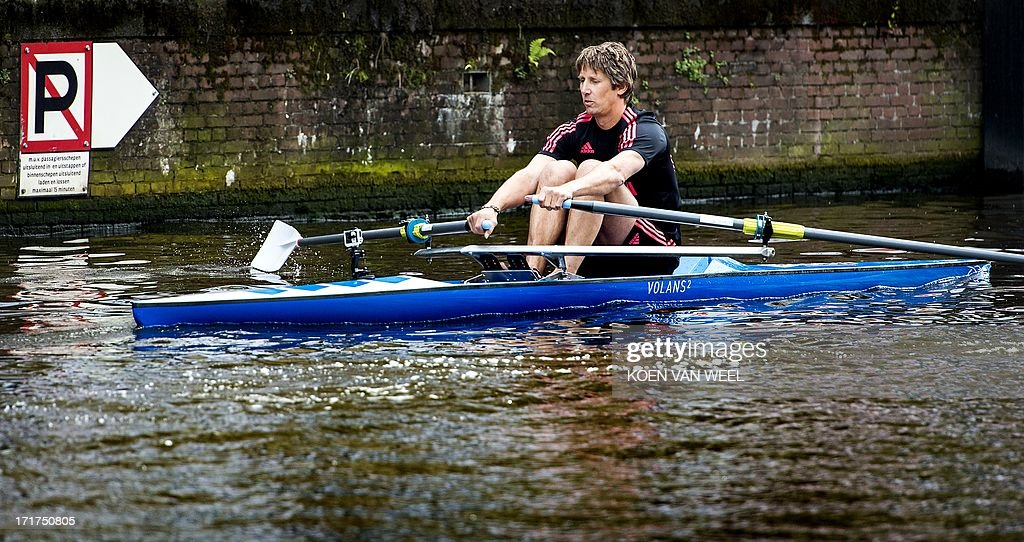Former Dutch international and Manchester United and Juventus Turin football clubs goalkeeper Edwin van der Sar competes in AEGON City Rowing Amsterdam, a 200m race, on the canal of the Keizersgracht in Amsterdam, on June, 28 2013.