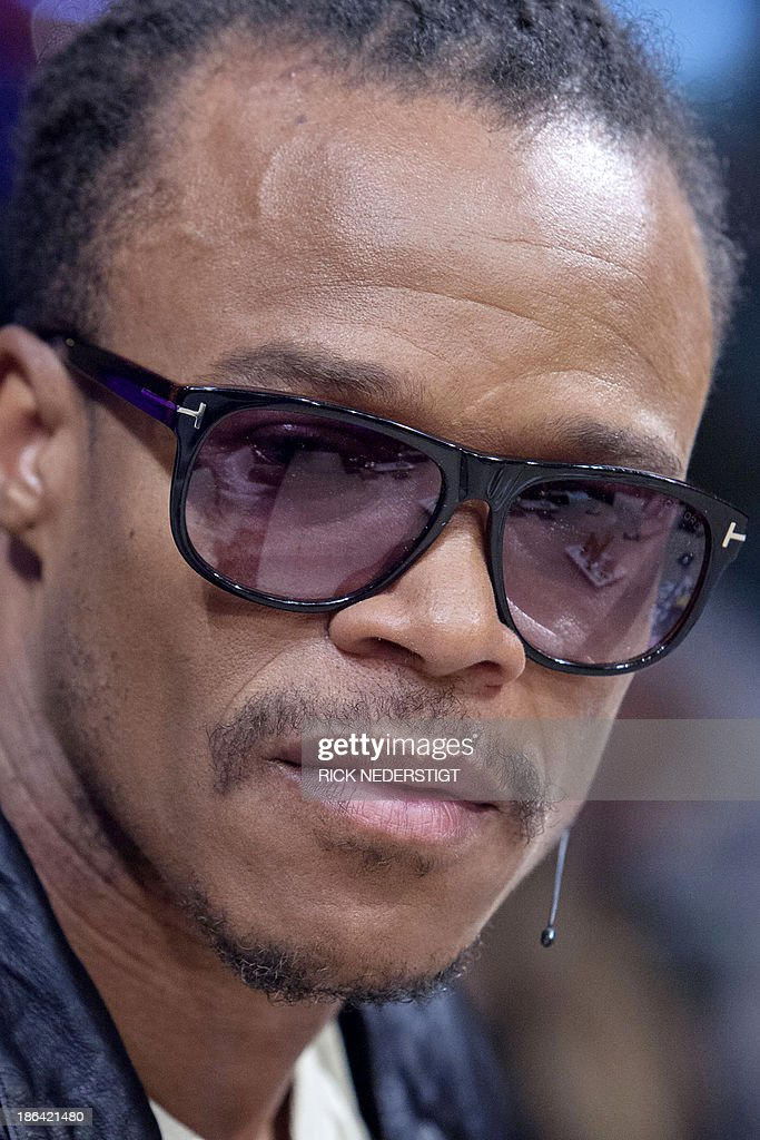 Former Dutch international football player Edgar Davids shows his moustache during the Dutch television show RTL Late Night in Amsterdam, The Netherlands on October 30, 2013. Davids is growing his moustache as ambassador for Movember (for moustache and 'November'), the annual month-long event involving the growing of moustaches during the month of November to raise awareness of prostate cancer and other male cancer and associated charities. AFP PHOTO / ANP / RICK NEDERSTIGT